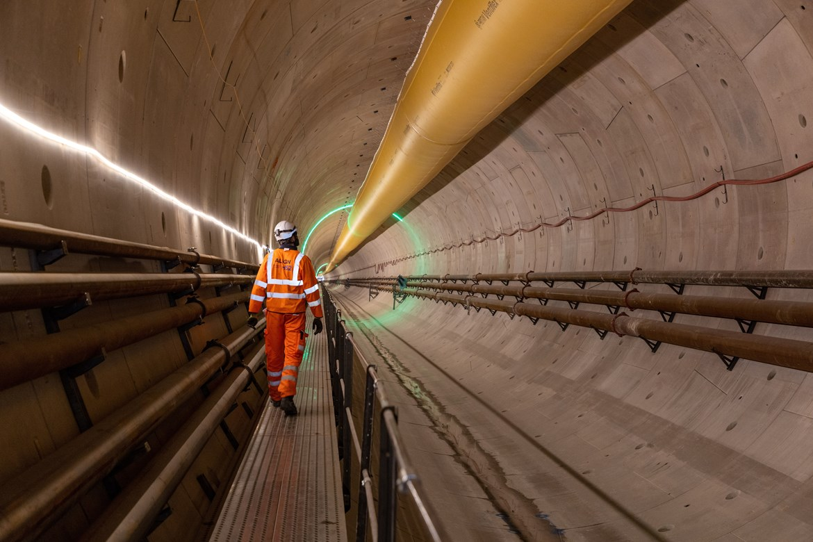 Tunnel progress as HS2 completes first mile under the Chilterns: Image of a man walking within the Chiltern tunnel autumn 2021 #28599-2