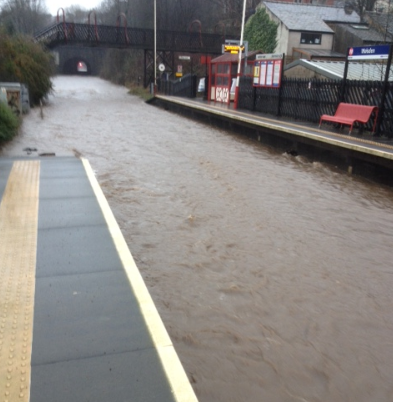Floods disrupt railway in North of England: 'Check before you travel': Walsden station flooded, Boxing Day