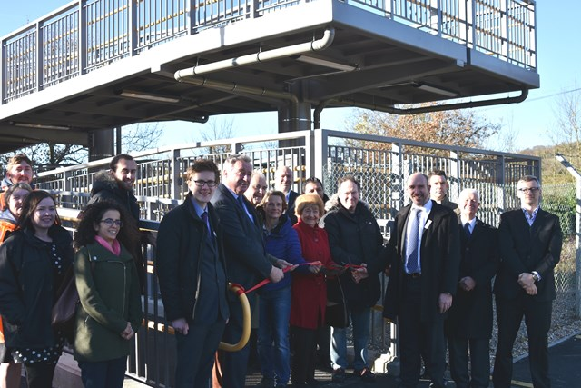 Stuart Kistruck, director of route asset management at Network Rail cuts the ribbon to officially open Rosa's bridge in Gomshall.: Also attending the opening were: David Gould, Rosa Sigal's great-nephew; Beatrice Gould, Rosa Sigal's niece; Tom Pierpoint, Great Western Railway; Sir Paul Beresford, MP for Mole Valley; Cllr Keith Taylor, Surrey County Council; Cllr David Wright, Guildford Borough Council; Cllr Candace Brooke, Shere Parish Council; representatives from Network Rail and Osborne's, the appointed contractor.