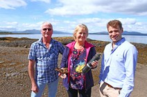 IMG 4671: Environment Secretary Roseanna Cunningham was in Oban today (9 Aug) to announce a new research programme to monitor the common skate. Skate populations have declined by over 90% over the past 100 years due to overfishing.  Pictured here with local fisherman Ronnie Campbell, and Dr James Thorburn of St Andrews University.