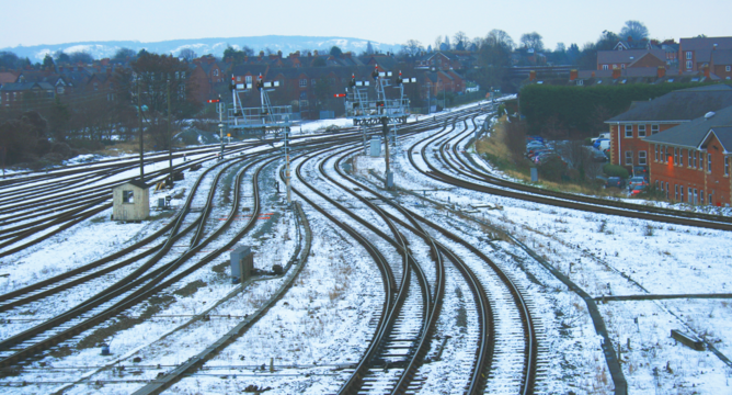Snow covered railway - signals: winter weather