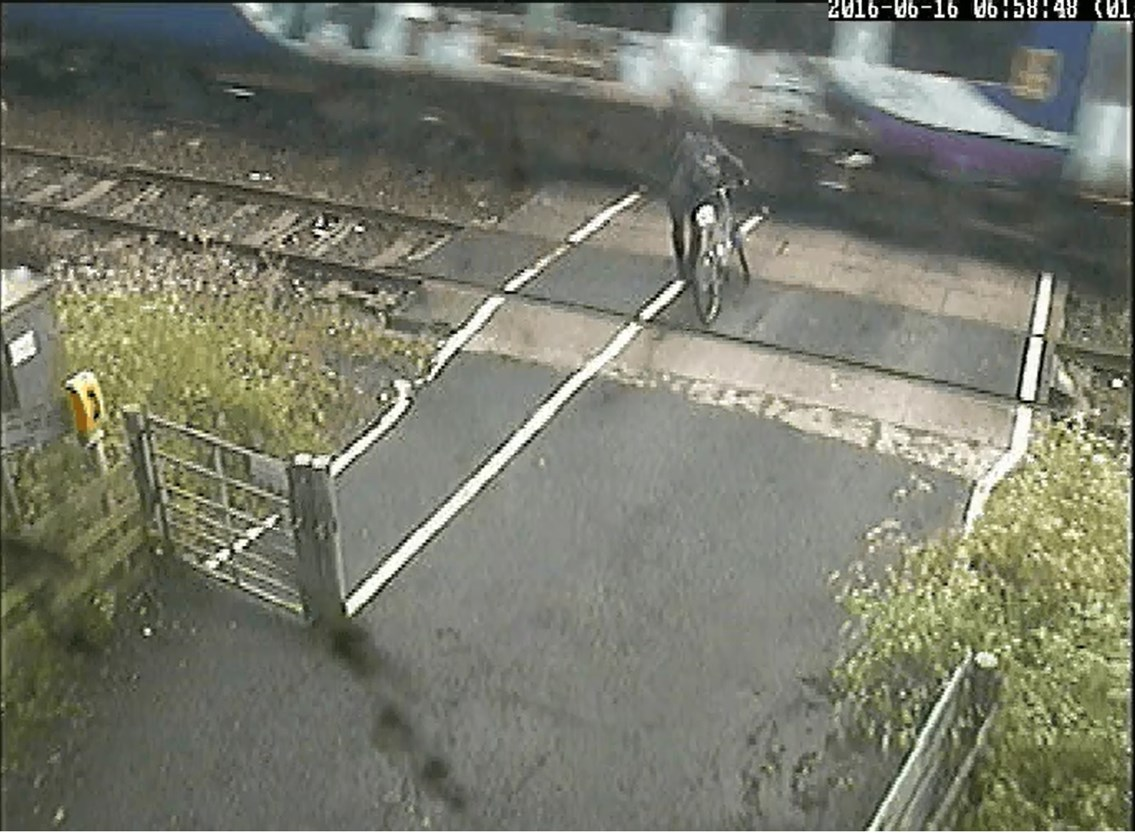 CCTV shows cyclist in terrifying near-miss with train: Ducketts Level Crossing