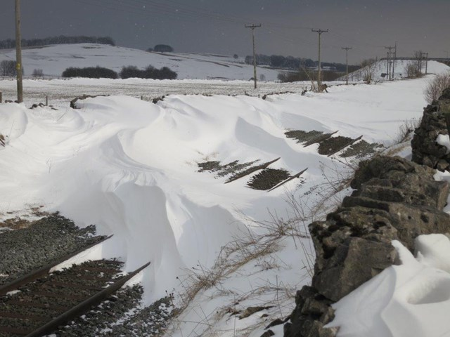 Snow covered railway - drifts: winter weather