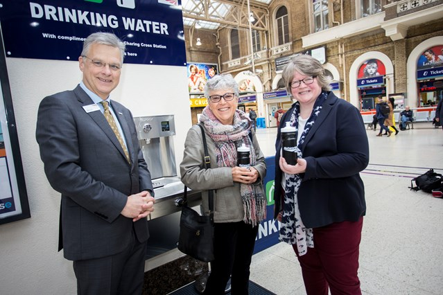 Free drinking water on tap for Kent, Sussex and South East London rail passengers at Charing Cross: First water fountain user at London Charing Cross is Sheila Pearce of Chislehurst. Also pictured Network Rail's chief executive  Mark Carne and Thérèse Coffey MP, Parliamentary Under Secretary of State at DEFRA