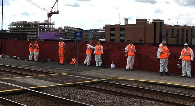 Volunteers from Network Rail cleaned the graffiti from near the railway in Sheffield-2