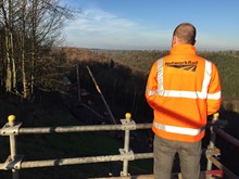 Network Rail staff looking over the work ongoing at Eden Brows