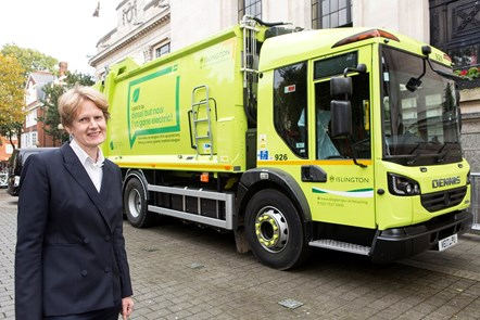 Cllr Champion alongside the retrofitted refuse collection vehicle