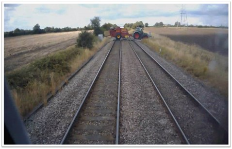 train travelling 85mph narrowly misses farm vehicle at level crossing  2