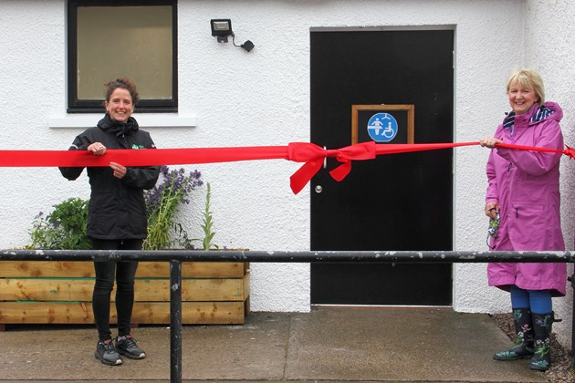 MSP Mairi Gougeon (L) and PAMIS chef exec Jenny Miller (R) open the new, accessible toilet block at St Cyrus NNR. Photo credit Pauline Smith