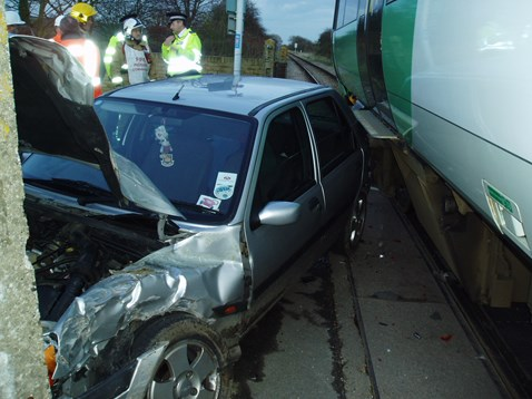 Motorist collides with train after running red lights at Winchelsea level crossing, Sussex
