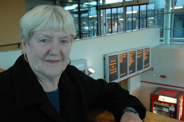 Stockport information screens: Councillor Marueen Rowles on the balcony above the newly installed information screens in the station foyer at Stockport (11 December 2006).