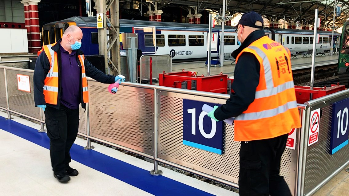 Tests show no traces of Covid-19 at Liverpool Lime Street station: Liverpool Lime Street cleaning handrails stock shot