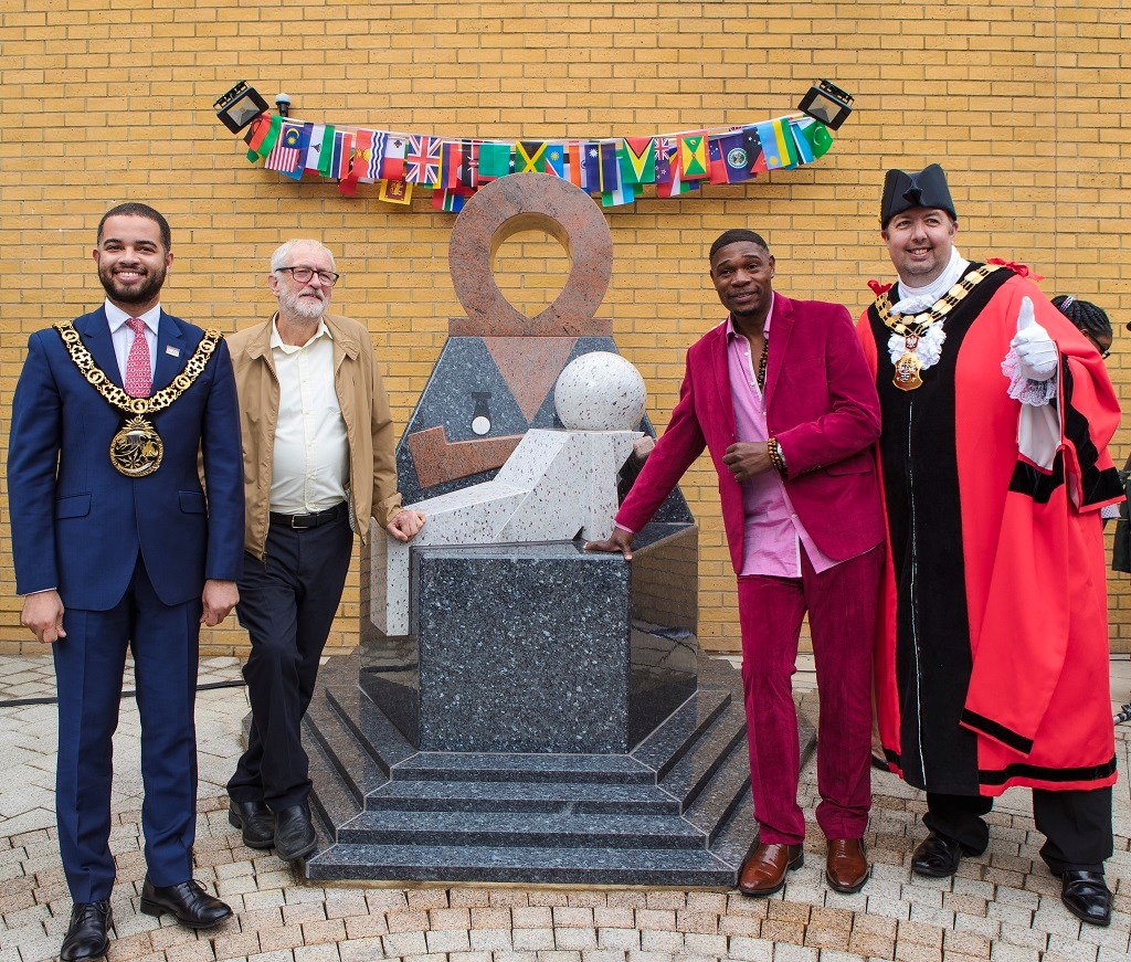 The statue to commemorate Windrush and Commonwealth NHS nurses and midwives is unveiled at the Whittington. (Credit: Patrick Lewis): From left to right: Cllr Adam Jogee (Mayor of Haringey Council); Jeremy Corbyn MP; Jak Beula (Founder of Nubian Jak Community Trust); Cllr Troy Gallagher (Mayor of Islington Council)