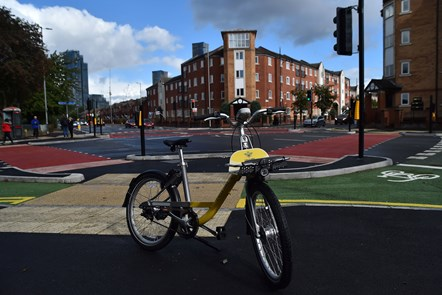 CYCLOPS launch Hulme-3: Front on shot of a branded Bee bike parked on a stand at the new CYCLOPS junction in Hulme.