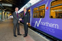 Martin Jurkowski and Rob Warnes with the first electric train to operate between Liverpool Lime Street station and Manchester Airport station