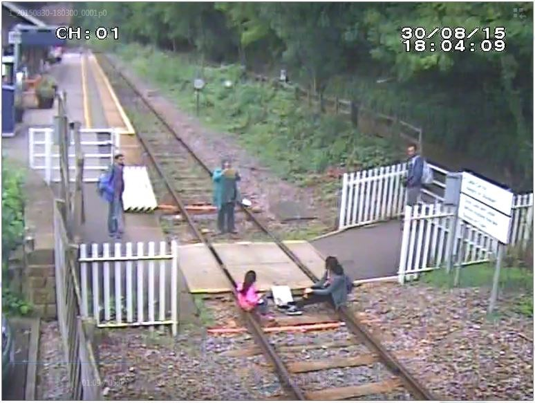 Rail safety warning as crossing users seen taking selfies and lying on the track in Derbyshire: Matlock Bath - Children sit on rails while mother takes picture