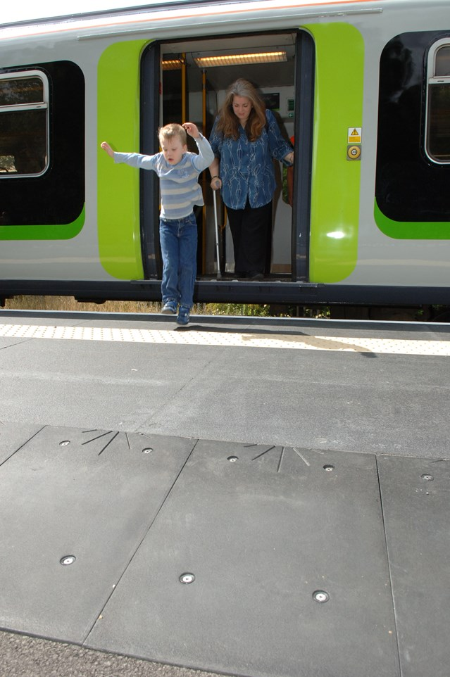 ST ALBANS ABBEY RAIL USERS HAPPY TO GET THE HUMP: Young boy jumping down onto new 'hump' at St Albans Abbey