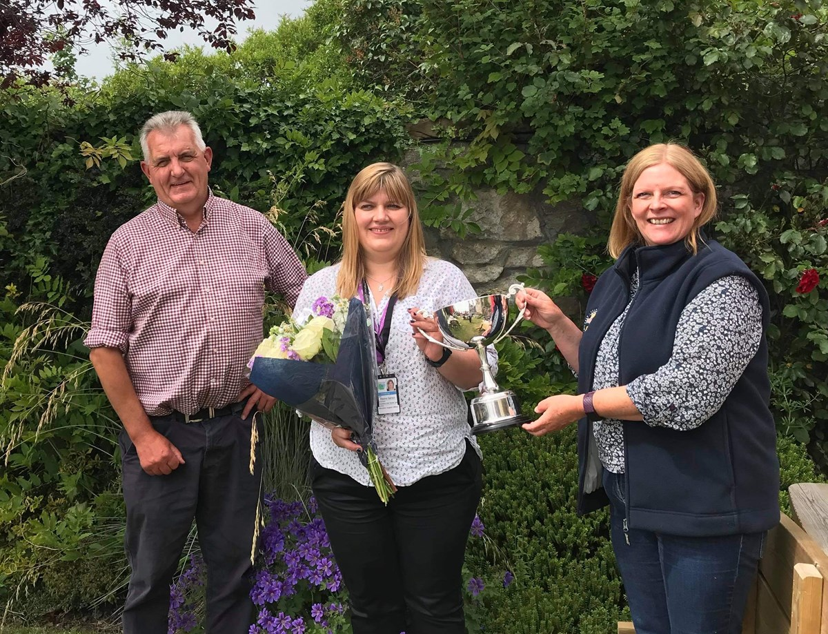 Maxine Garson receiving John Telfer Trophy 2021: L-R: Martin Birse, Director RNCI; Maxine Garson; Alison Johnston, RNCI Project Manager