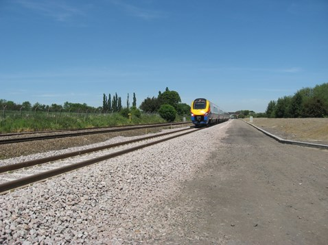 Train running along new 3rd line between Kettering and Harrowden junctions