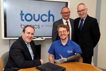 (Sitting l-r) Paul Wheelhouse, Patrick Kane, (Standing l-r) Hugh Gill, Michael Cannon: (Sitting l-r) Paul Wheelhouse, Scottish Government Minister for Business, Innovation & Energy, Patrick Kane, patient ambassador for Touch Bionics (Standing l-r) Hugh Gill, Vice President of Research & Development at Touch Bionics, Michael Cannon, Head of Innovation & Enterprise Services at Scottish Enterprise