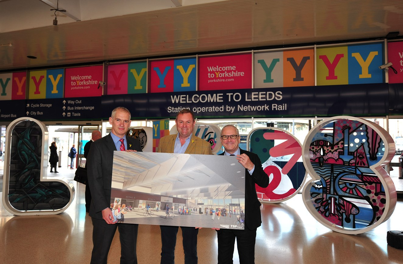 Let there be light! Plans announced for new transparent roof at Leeds Railway Station: Rob McIntosh, Sir Gary Verity DL and Sir Peter Hendy CBE with the artist impression of the new south concourse roof