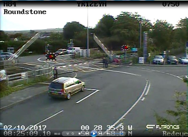 VIDEO: Warning to road users after CCTV spots cyclist getting stuck behind level crossing gates in West Sussex: Roundstone level crossing CCTV still