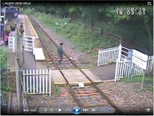 Matlock Bath - Man walks on the  track while on the phone