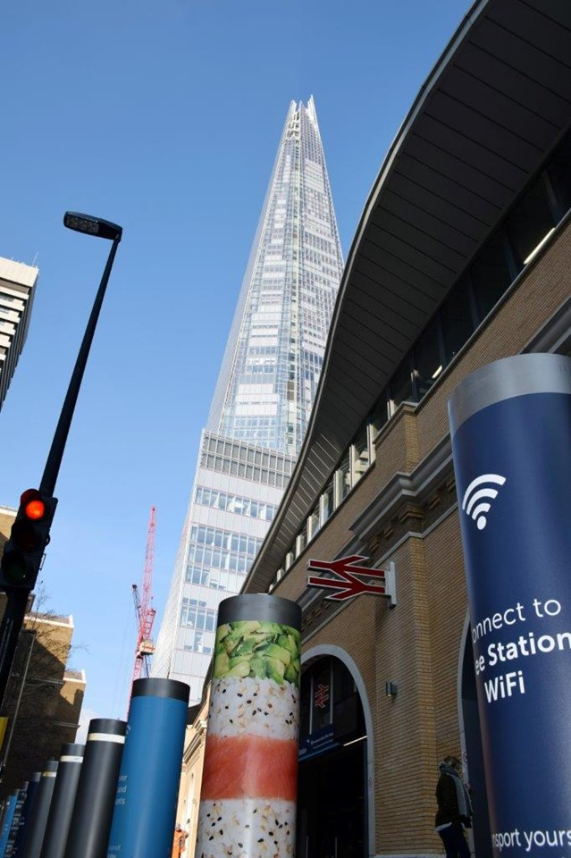 London Bridge station with Shard in distance and wifi poster