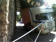 Bridge strike: Lorry wedged beneath railway bridge following bridge strike