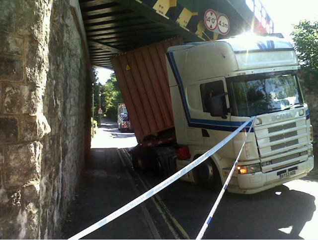 Bridge strike: Lorry wedged beneath railway bridge following bridge strike