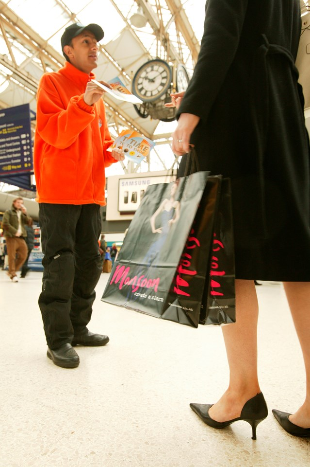 Time to Shop 1: Christmas shopper receives Time to Shop discount vouchers at Waterloo station