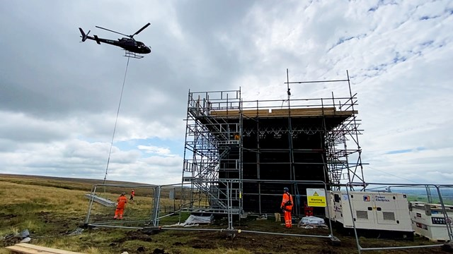 Wide shot of Cowburn Tunnel helicopter airlift