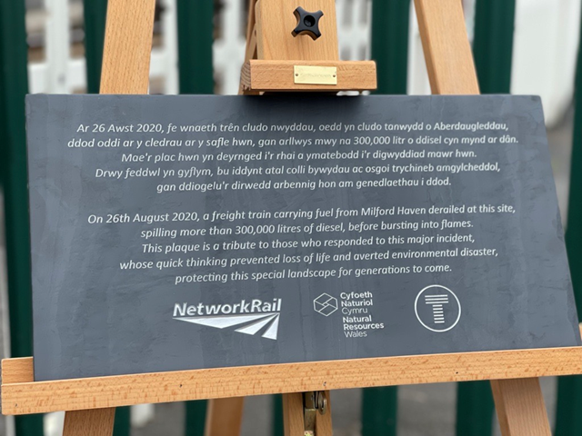Llangennech anniversary plaque-2: The first anniversary plaque donated to the village of Llangennech by Network Rail, Natural Resources Wales and Transport for Wales. The plaque is a thank you to all who responded to this incident and the community.