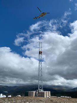 Engineers installing telecoms mast