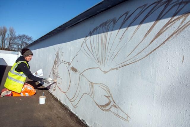 Photo credit Eloise Ross, Emma Garness painting on Love Lane bridge