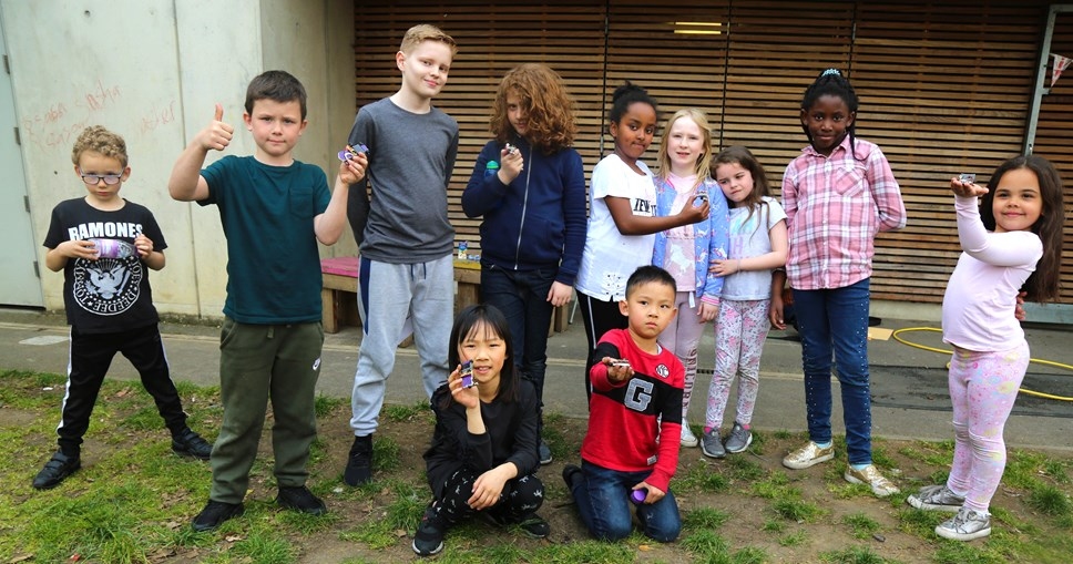 Solar powered toy cars help Islington's innovative efforts to reduce carbon footprint: Children from Three Corners Adventure Playground with solar powered toy cars