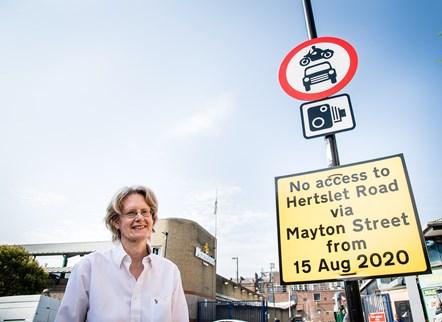 Cllr Rowena Champion alongside new signage installed on Mayton Street
