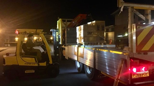 Network Rail supports army to deliver vital medical face masks to NHS frontline: Pallets of face masks being unloaded in Hampshire
