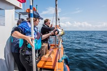 The team at Woods Hole Oceanographic Institution (WHOI), prepare to deploy their underwater robot camera © Jane Morgan  WWF UK