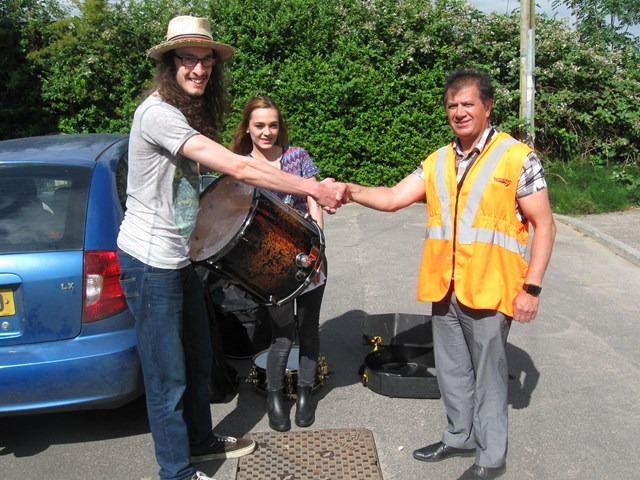 Morgan Pettigrew gets his rare stolen drumkit back from Network Rail engineer Derek Wahid-2