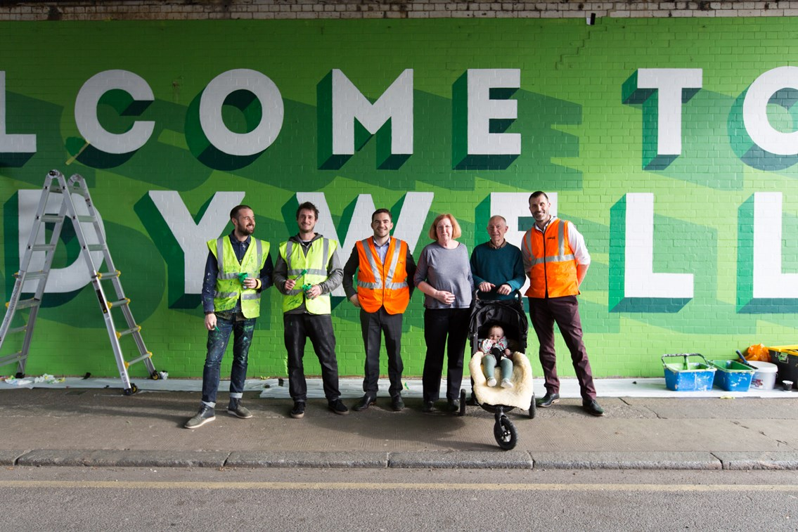 Railway bridge mural brightens up Ladywell: Network Rail staff, Bread Collective artists and local residents pose for a picture at the new mural at Ellerdale Street, Ladywell