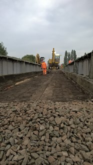 Laying ballast over the new bridge