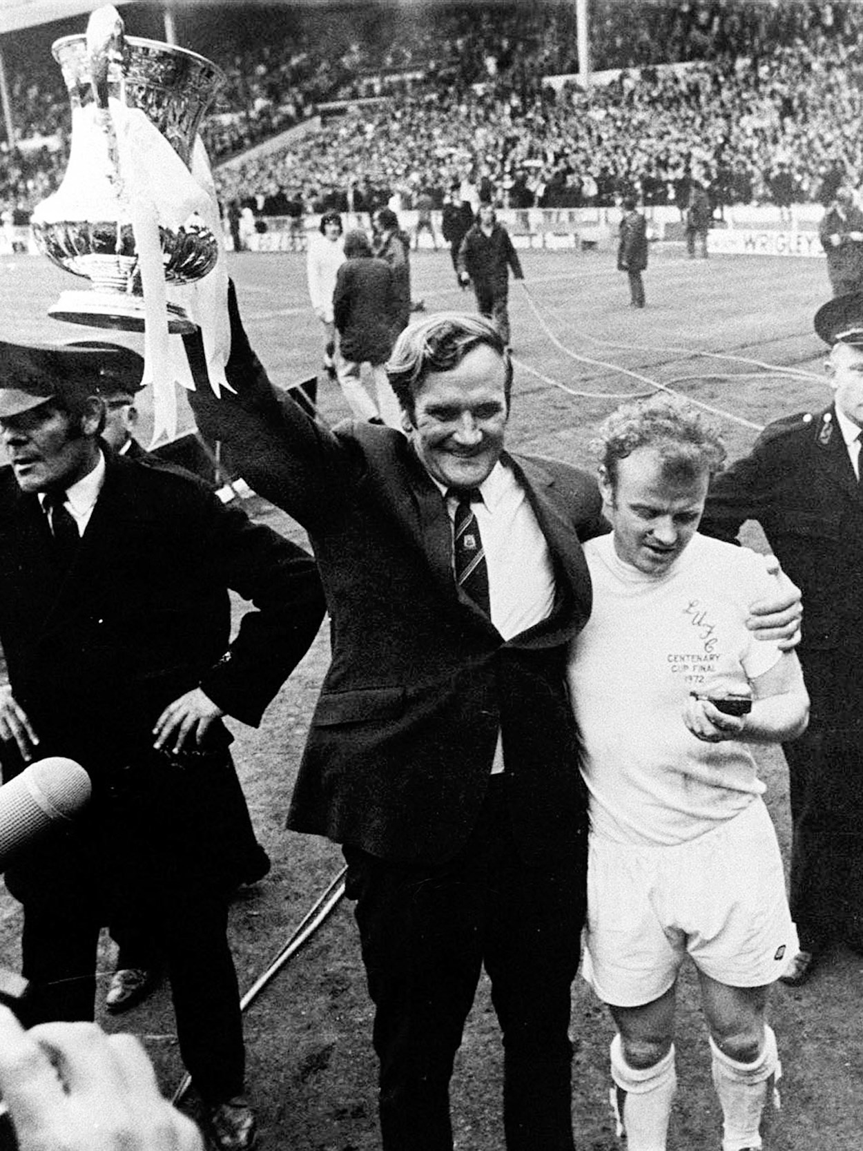 Don Revie and Billy Bremner 1972. Image: © Varley Picture Agency: Don Revie manager of Leeds United holding aloft the FA Cup in 1972 after the team beat rivals Arsenal 1-0 in the cup final. He is embracing the captain, Billy Bremner. Image: © Varley Picture Agency.