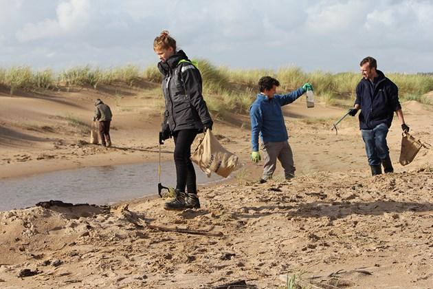 Challenge to bring Forvie beach clean to next level: Forvie NNR - SNH staff volunteer day - picking up rubbish on Forvie beach clean - credit SNH