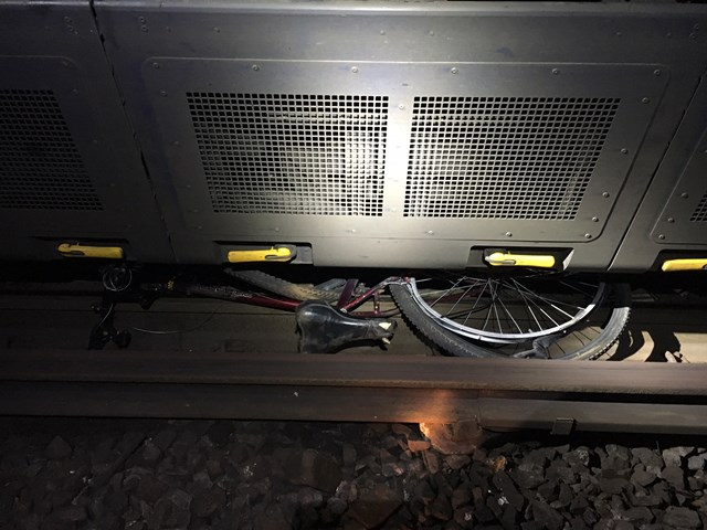Pictures: Dumped pushchair and bicycle delayed Kent rail passengers - Can you help catch culprits?: Pictures: Dumped pushchair and bicycle delayed Kent rail passengers - Can you help catch culprits?: Bicycle jammed under train, Gravesend