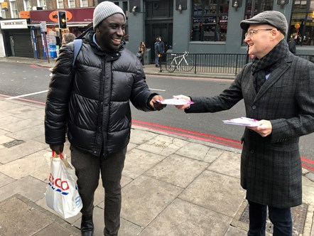 Founder of Debt Hacker Alan Campbell leafleting around Finsbury Park