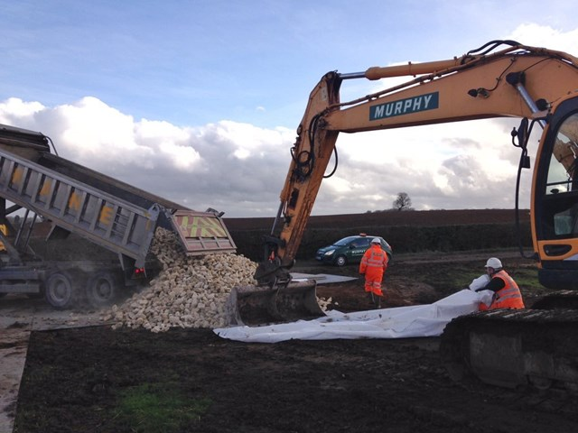 Amended timetable for train passengers as Leighton Buzzard bank slip is repaired: Leighton Buzzard, lorry load of railway foundation stone delivered to site