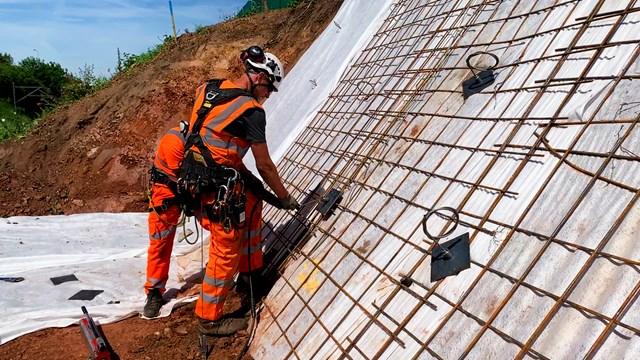 Engineers securing railway embankments at Penkridge