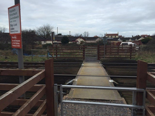 Children warned of the dangers of playing on the railway following near miss at Welsh level crossing: Sandy Lane level crossing