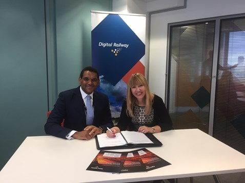 David Waboso, group managing director for Digital Railway and Anna Ince, chief executive officer at Resonate signing the two year contract